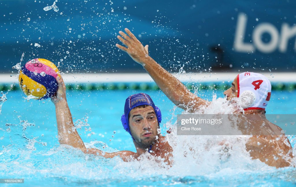 Vanja Udovicic of Serbia is challenged by Antonio Petrovic of Montenegro during the Men's Bronze Medal Match between Montenegro and Serbia on Day 16...