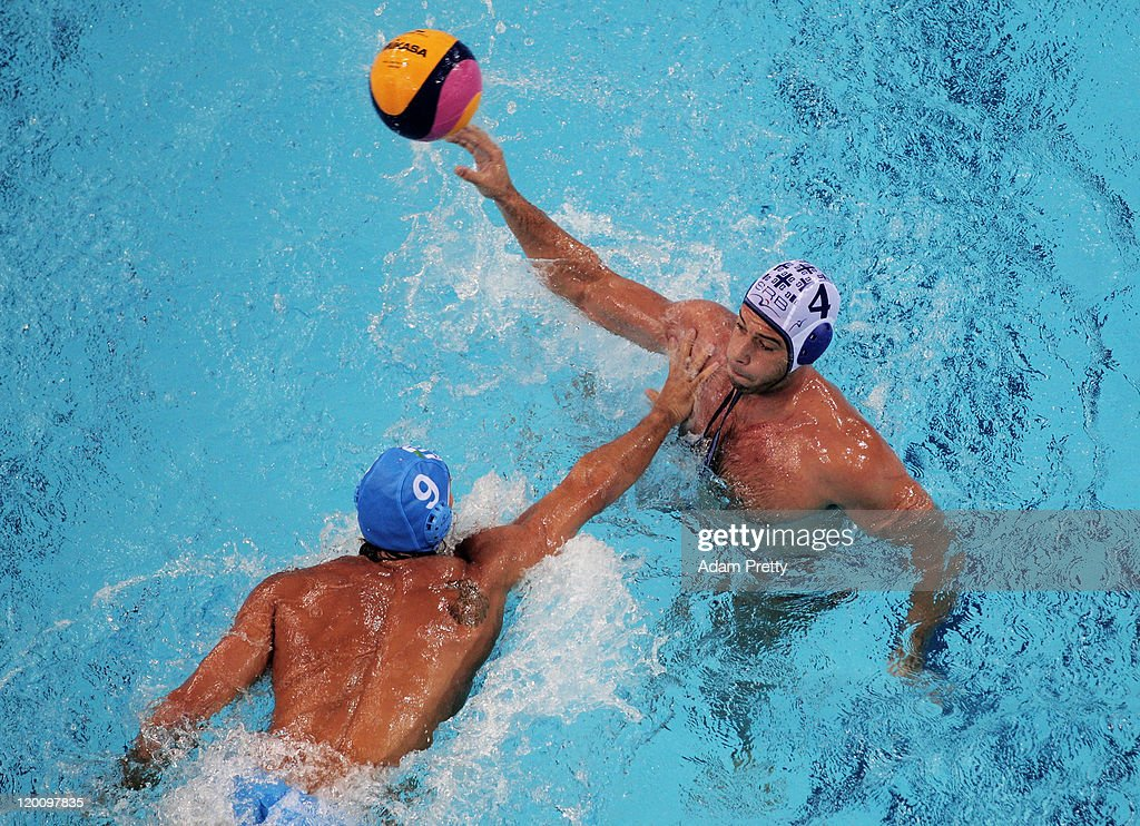 Vanja Udovicic of Serbia is challenged by Christian Presciutti of Italy in the Men's Water Polo gold medal match between Serbia and Italy during Day...