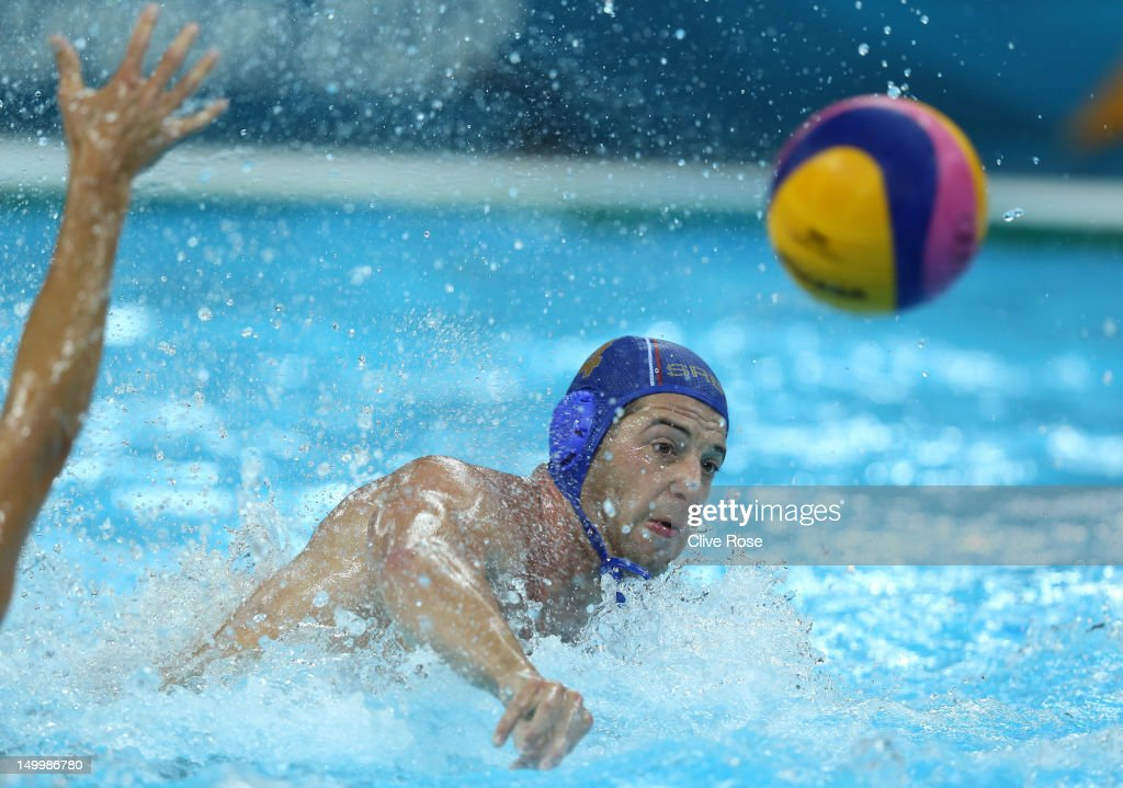 Vanja Udovicic of Serbia throws a pass in the Men's Water polo quarterfinal match between Australia and Serbia on Day 12 of the London 2012 Olympic...