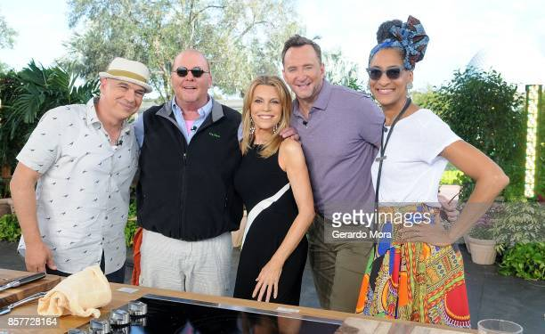 Vanna White and 'The Chew' cohosts Clinton Kelly Mario Batali Michael Symon and Carla Hall pose at Epcot Center at Walt Disney World on October 4...