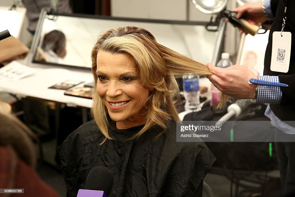 <a gi-track='captionPersonalityLinkClicked' href=/galleries/search?phrase=Vanna+White&family=editorial&specificpeople=1375107 ng-click='$event.stopPropagation()'>Vanna White</a> prepares backstage at The American Heart Association's Go Red For Women Red Dress Collection 2016 Presented By Macy's at The Arc, Skylight at Moynihan Station on February 11, 2016 in New York City.
