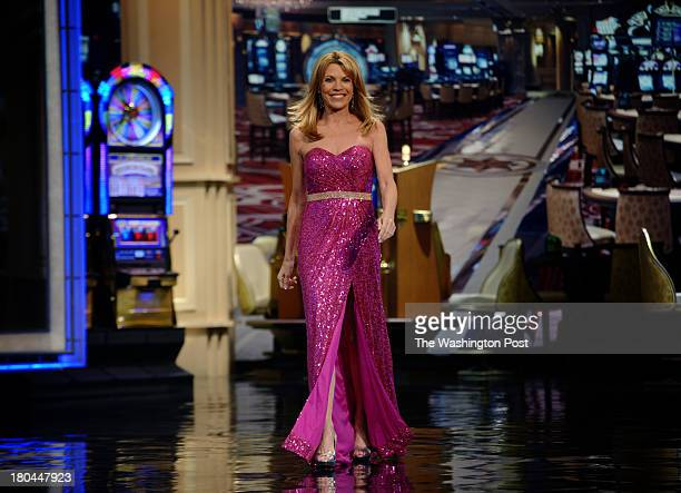 Vanna White who has been turning letters on the Wheel of Fortune for 30 years walks onstage for another taping on July 2013 in Las Vegas NV