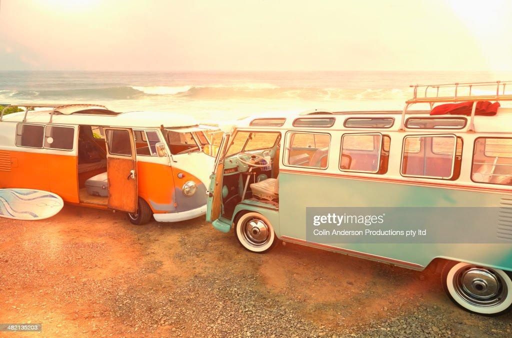 Vans parked on beach : Stock Photo