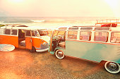 Vans parked on beach