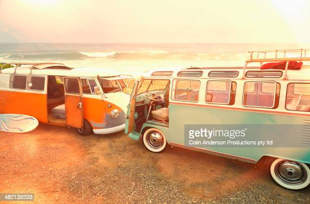 Vans parked on beach