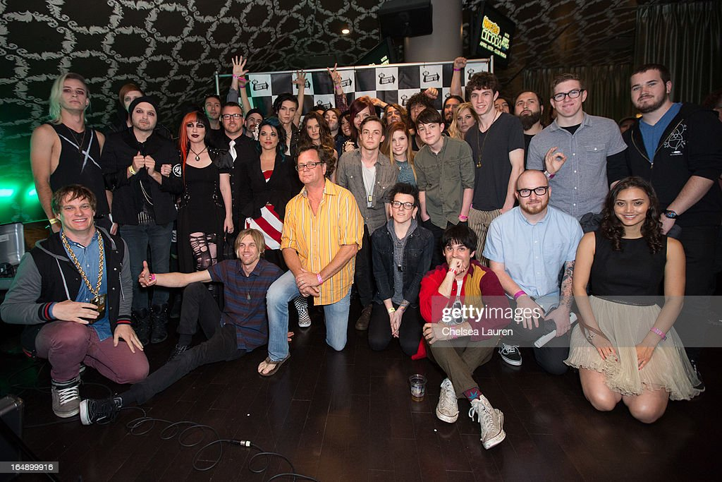 Vans Warped Tour founder Kevin Lyman (C) and the 2013 performers pose at the Vans Warped Tour press conference and kick-off party at Club Nokia on March 28, 2013 in Los Angeles, California.