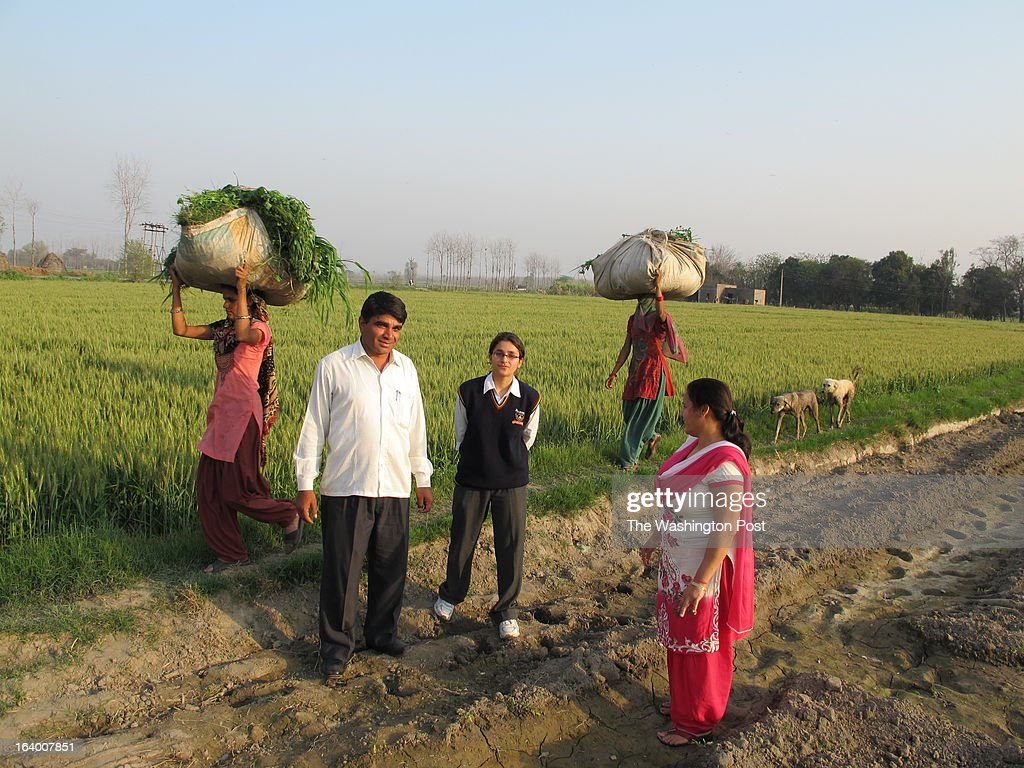 Vanshika Sachdeva, a 12th grade high-school student, is the first in her family to speak fluent English poses with her father (L), Jagdish Sachdeva, who is a farmer, and her mother (R), Anita Sachdeva, who is a village council chief, in their wheat fields in Rajhedi, India on March 11, 2013. She rides a motorcycle in her wheat-growing Rajhedi village in northern state of Haryana, downloads almost everything on her smart phone and plays volleyball. But when it comes to choice of career, Sachdeva defers to her parents. A new survey says that about 84 per cent of respondents in the survey said that their family elders guided them on education and career choices. It says that aspirations are largely misaligned with the skills that India requires over the next decade, leaving many young people ill-equipped to help Indian economy grow.