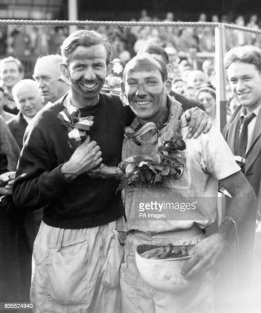 Vanwall drivers Tony Brooks and Stirling Moss celebrate victory in the British Grand Prix The pair shared driving duties to take Vanwall's first...