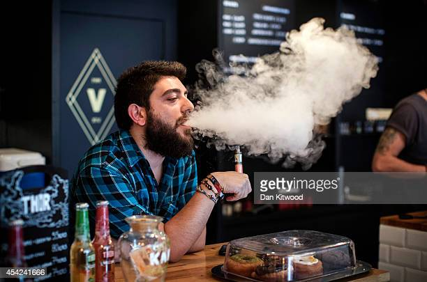 Vape Lab employee Leonardo Verzaro uses an ECigarette while working on August 27 2014 in London England The Department of Health have ruled out the...
