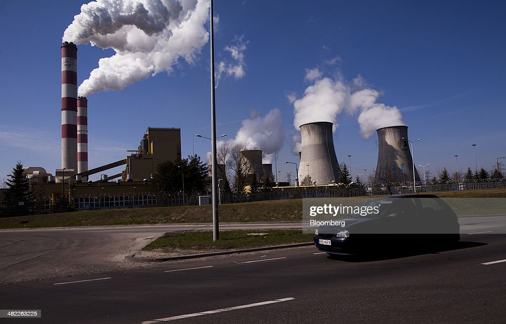 Vapor escapes from chimneys and cooling towers at the lignite coal-fired power plant operated by PGE Elektrownia Belchatow SA near Belchatow, Poland, on Wednesday, April 2, 2014. Polish power prices are set to stay above German contracts through 2015, reversing a historic discount, as the cost of keeping plants open in the eastern European nation is factored in, according to Vattenfall AB. Photographer: Bartek Sadowski/Bloomberg via Getty Images