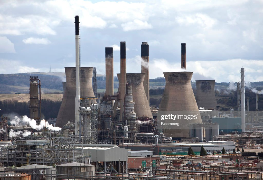 Vapor is seen rising from the cooling towers at the Grangemouth refinery, Scotland's sole oil refinery, operated by Ineos Group Holdings Plc., in Grangemouth, U.K., on Wednesday, May 1, 2013. Grangemouth will halt several units for maintenance work in September, according to two people with direct knowledge of the partial shutdown plan. Photographer: Mike Wilkinson/Bloomberg via Getty Images
