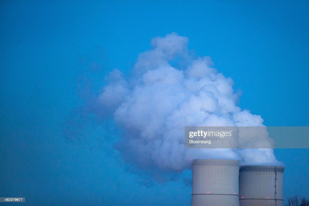 Vapor rises from the cooling towers of the Schwarze Pumpe lignite powered power plant, operated by Vattenfall AB, in Spremberg, Germany, on Saturday, Jan. 11, 2014. Across the continent's mining belt, from Germany to Poland and the Czech Republic, utilities such as Vattenfall AB, CEZ AS and PGE SA are expanding open-pit mines that produce lignite. Photographer: Krisztian Bocsi/Bloomberg via Getty Images