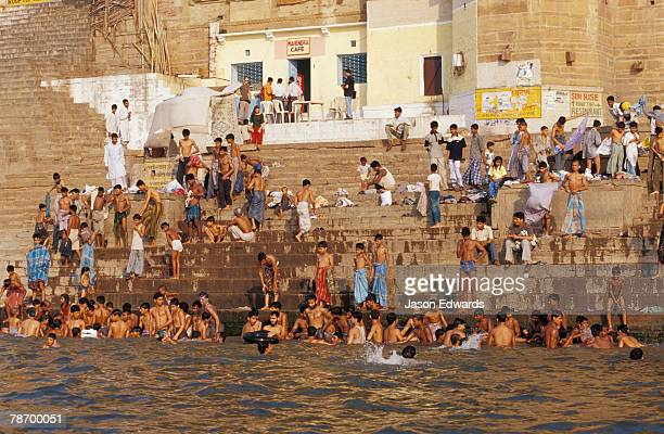 Men and boys bathe at an ancient ghat along the holy Ganges River.