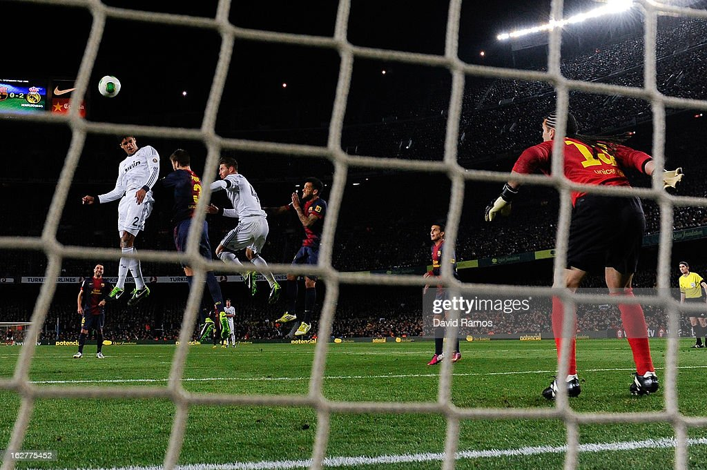 Varane (L) of Real Madrid CF scores his team's third goal during the Copa del Rey Semi Final second leg between FC Barcelona and Real Madrid at Camp Nou on February 26, 2013 in Barcelona, Spain.