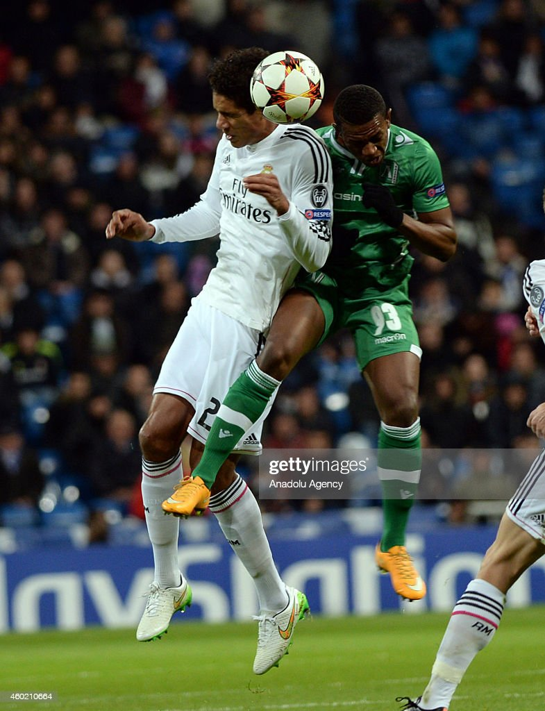 Varane of Real Madrid (L) vies <a gi-track='captionPersonalityLinkClicked' href=/galleries/search?phrase=Virgil&family=editorial&specificpeople=78328 ng-click='$event.stopPropagation()'>Virgil</a> Misidjan of Ludogorets Razgrad (R) during the UEFA Champions League Group B football match between Real Madrid CF and PFC Ludogorets Razgrad at the Santiago Bernabeu Stadium in Madrid, Spain on December 9, 2014.