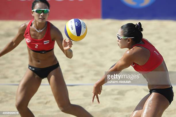 Varapatsorn Radarong and Tanarattha Udomchavee of Thailand in action during the Women's Beach Volleyball Preliminary Round 2014 Asian Games match...