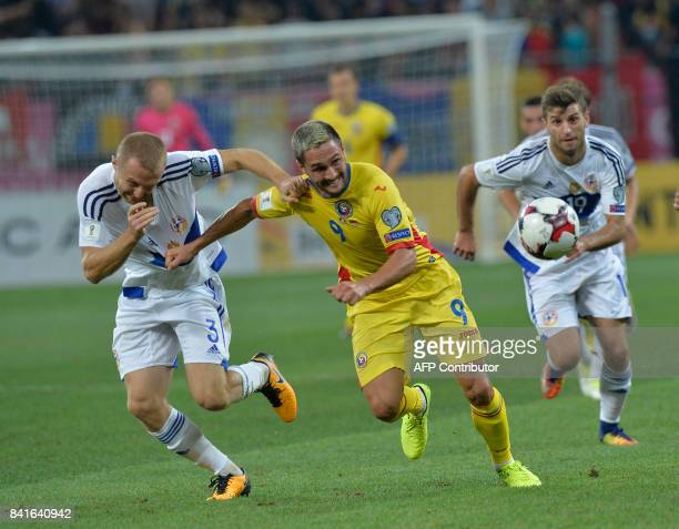 Varazdat Haroyan of Armenia vies for the ball with Florin Andone of Romania during the FIFA World Cup 2018 qualification football match between...