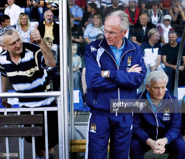 name correction***** A supporter gestures to Manchester City coach Sven Goran Eriksson as Hans Backe assistant coach sits on the bench during the 18...