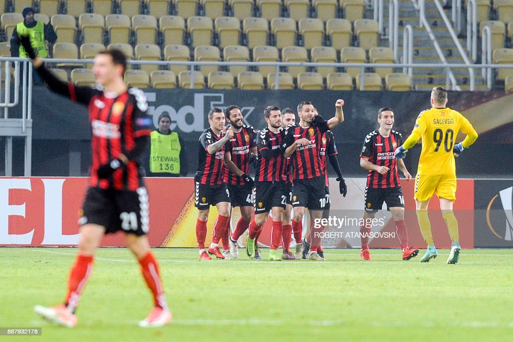 Vardar's players celebrate after scoring a goal during the UEFA Europa League group L football match between FK Vardar and Rosenborg BK at the Filip II Arena in Skopje on December 7, 2017. / AFP PHOTO / Robert ATANASOVSKI