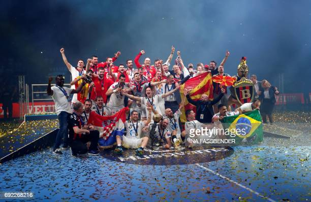 Vardar's team poses with the trophy for a team photo after the victory ceremony of the Handball EHF Champions League final Four final match between...