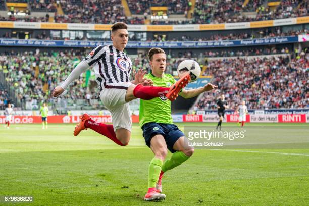 Varela Guillermo of Frankfurt and Yannick Gerhardt of Wolfsburg fight for the ball during the Bundesliga match between Eintracht Frankfurt and VfL...