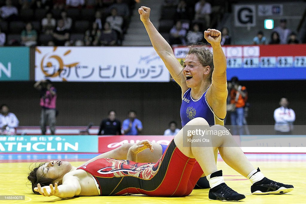 Vareria Zholobova (R) of Russia celebrates winning the 55kg division of the final match against <a gi-track='captionPersonalityLinkClicked' href=/galleries/search?phrase=Saori+Yoshida&family=editorial&specificpeople=2374710 ng-click='$event.stopPropagation()'>Saori Yoshida</a> (L) of Japan during day two of the 2012 Female Wrestling World Cup at Yoyogi National Gymnasium on May 27, 2012 in Tokyo, Japan.