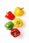 Variation of different color bell peppers on a white background. Colorful paprikas viewed from above isolated on white. Top view