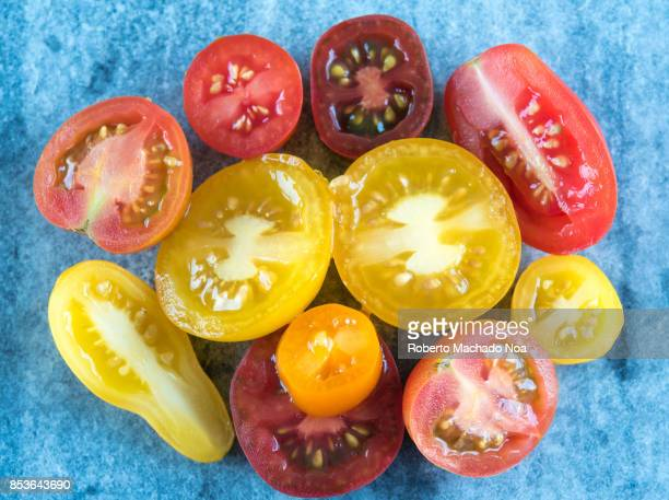 Varieties of Mexican cherry tomatoes cut in halves Cherry tomatoes are believed to go as far back as Aztec Mexico in at least the 15th century