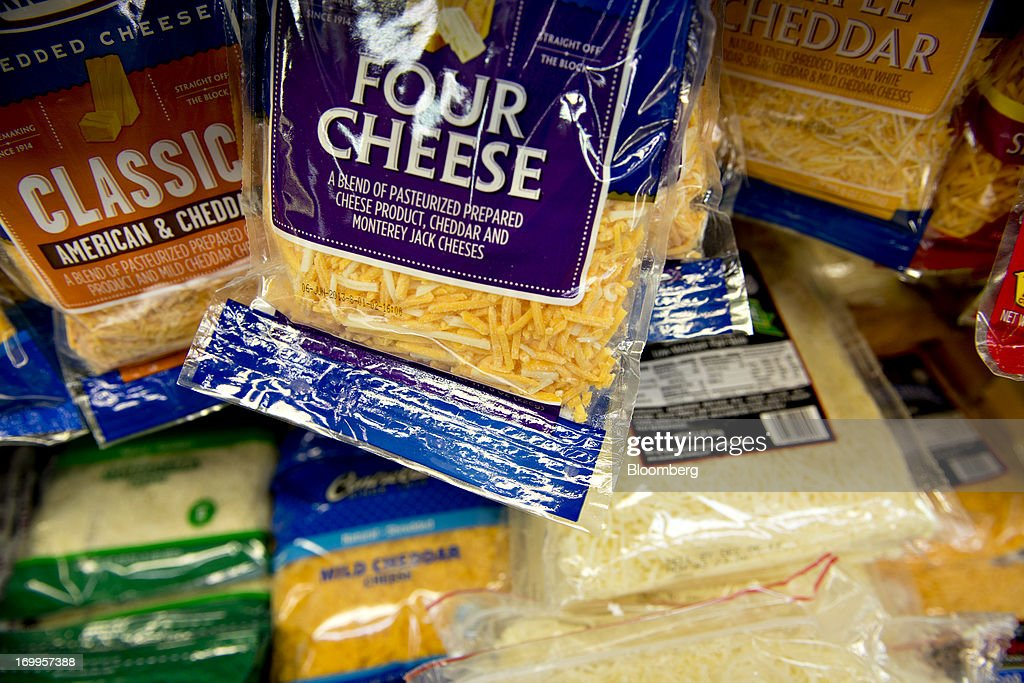 Varieties of shredded cheese sit on display at a supermarket in Princeton, Illinois, U.S., on Tuesday, June 4, 2013. The Food and Agriculture Organization of the United Nations will release its monthly food price index on June 6. The index, a measure of the monthly change in international prices of a basket of food commodities, consists of the average of five commodity group price indices including meat, dairy, grains, oil and sugar. Photographer: Daniel Acker/Bloomberg via Getty Images