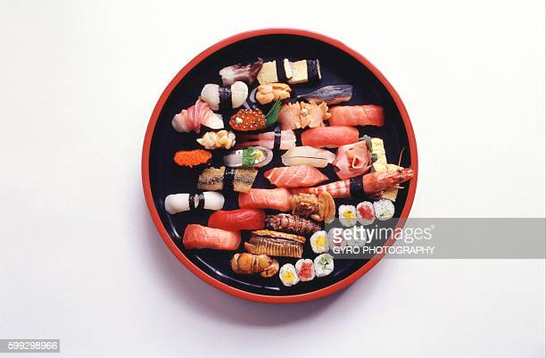 Varieties of sushi in container