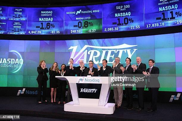 Variety EditorInChief Andrew Wallenstein and guests ring the NASDAQ Closing Bell at NASDAQ MarketSite on April 30 2015 in New York City