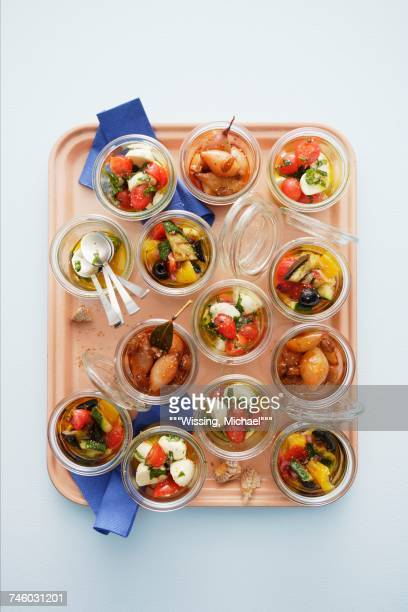 A variety of appetisers in glasses