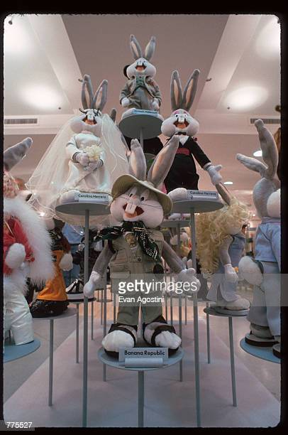 A variety of Bugs Bunnies are on display wearing designer clothing at the Warner Bros Studio store October 23 1996 in New York City The store...