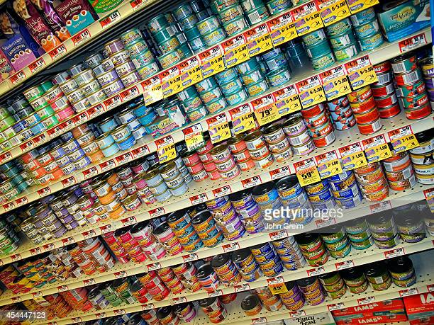 Variety of canned cat food products on a store shelf