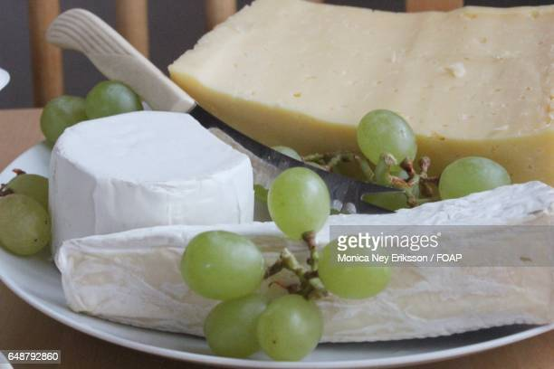 Variety of cheese and grapes in plate