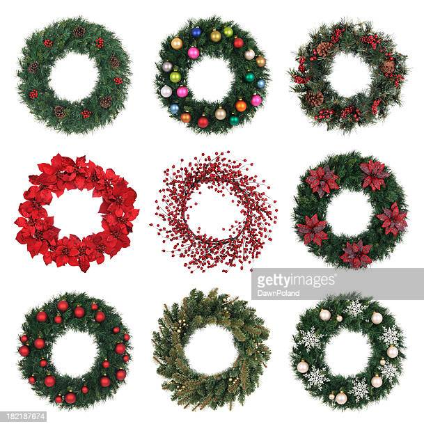 A variety of decorated holiday wreaths