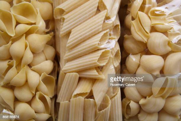 Variety of different shapes of pasta in bags.