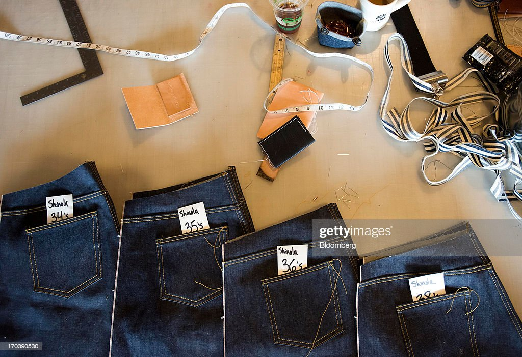 A variety of different sized denim jeans sit unfinished on a table at Detroit Denim, in Detroit, Michigan, U.S., on Wednesday, June 12, 2013. The Commerce Department is scheduled to release monthly business inventories data on June 13. Photographer: Ty Wright/Bloomberg via Getty Images