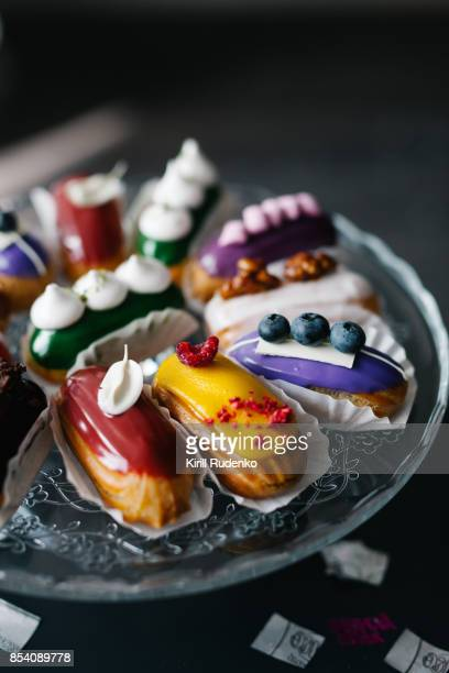 A variety of eclairs on a table setting