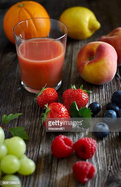 Variety of fresh fruit and fruit juice