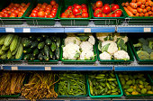 Variety of fresh vegetables on display in grocery store