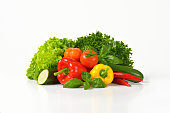 assortment of fresh vegetables on white background