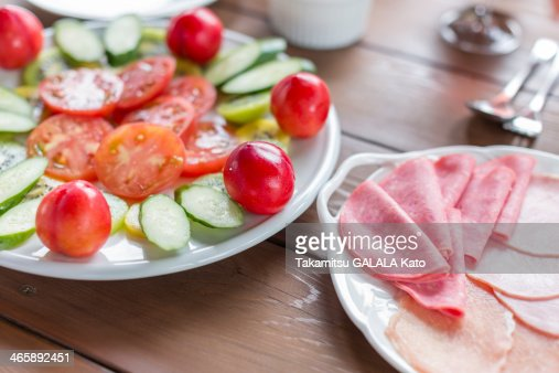 Variety of ham and cut vegetables