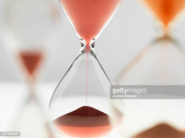 A variety of hour glass timers in use