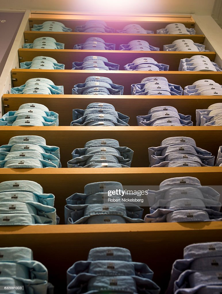 A variety of linen shirts are stacked for sale at a Uniqlo store in the Soho neighborhood of New York City on April 17 2016