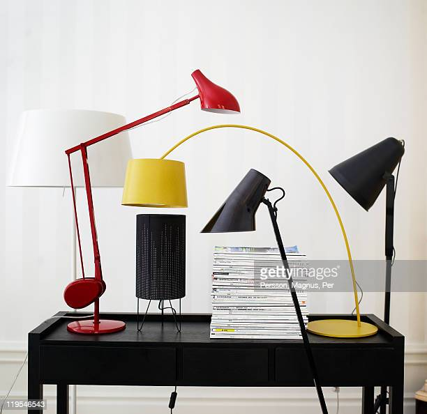 Variety of modern design lamps on top of desk
