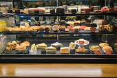 Variety of tasty pastry in glass display