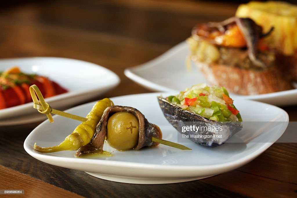 in foreground is Gilda Manzanilla Olive Guindilla Pepper and Anchovy paired with Marinated Mussels at left in back is CauliflowerStuffed Piquillo and...