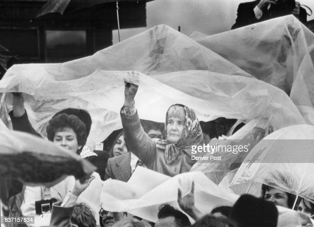 A variety of raingear is in evidence in audience during carter's seri appearance About 1000 people huddled beneath umbrellas and other protective...
