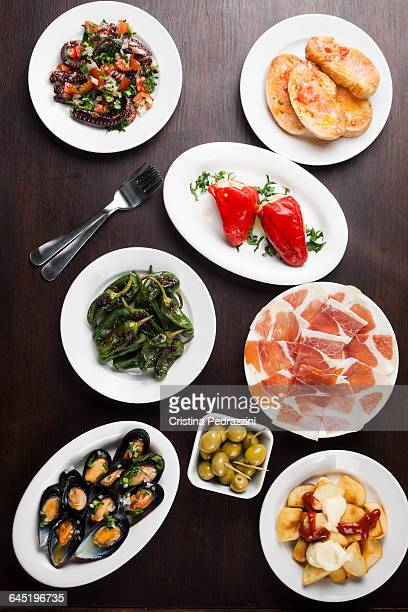 Variety of Spanish tapas on small plates